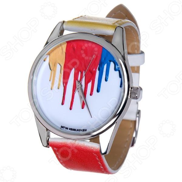 Часы наручные Mitya Veselkov Гуашь стильный аксессуар, сочетаются с необычной и яркой одеждой. Часы выполнены в оригинальном стиле в сочетании с приятными и мягкими тонами, которые добавляют настроение. Дизайн и ручная сборка Mitya Veselkov. Идеально подойдут для веселых вечеринок, прогулок под солнцем во время отдыха. Снабжены регулируемым под запястье ремешком из кожи. На циферблате не видны цифры. Часовой механизм: кварцевый, Citizen Япония . Характеристики:  Размер корпуса: 3,7см.  Стекло: минеральное.  Покрытие: PVD покрытие.  Корпус: сплав металлов.  Крышка корпуса: сталь. Особенности ремешка:  Натуральная кожа с лазерным нанесением цвета, повторяющим цвет принта циферблата.  Ширина ремешка: 2 см.  Длина ремешка с корпусом: 23,5 см .  Застежка ремешка: классическая.
