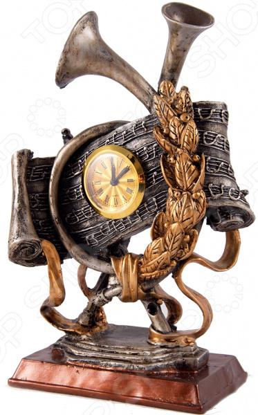 Часы настольные «Оскар» 28519Часы настольные<br>Часы настольные Оскар 28519 изделие, удивительным образом сочетающее в себе высокое качество, роскошный дизайн и практичность. Очень удобно, когда часы всегда под рукой. Они особенно пригодятся в рабочем кабинете или гостиной вы сможете легко контролировать свою деятельность и точно не опоздаете на важную встречу! Благодаря красивейшей бронзовой расцветке часы легко впишутся в любой интерьер. Они будут идеально гармонировать с мебелью и текстилем, а дизайн под старину внесет в помещение особый шарм и нотки роскоши. Циферблат с римскими цифрами на золотистом фоне. Часы работают от батареек типа АА в комплект не входят . В качестве рекомендации по уходу регулярное удаление пыли мягкой сухой тканью.<br>
