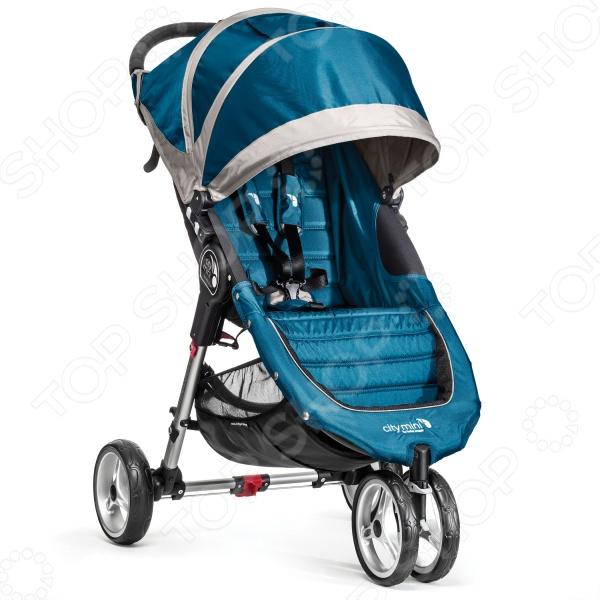Коляска прогулочная Baby Jogger ВО11429 сочетает в себе практичность, функциональность и стильный современный дизайн. Модель оснащена пятиточечными ремнями с мягкими подкладками для надежной фиксации малыша в коляске, капюшоном с вентиляционными окошками, анатомическим сидением с регулируемой спинкой, отсеком для детских принадлженостей и вместительной корзиной для покупок, выдерживающей нагрузку до 5-ти кг. Коляска весьма компактна в хранении, легко складывается одной рукой и остается в сложенном положении, благодаря системе автофиксации Quick Fold. Максимально допустимая нагрузка на коляску составляет 40 кг. Модель предназначена для детей в возрасте в до пяти лет.