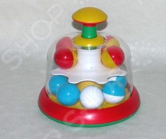 Юла-карусель Стеллар с шариками 10015Юла<br>Юла-карусель Стеллар с шариками 10015 станет чудесным подарком для вашего крохи и будет способствовать развитию у малыша мелкой моторики рук, координации движений и цветового восприятия. При нажатии на колпачек, шарики внутри юлы начинают крутиться и греметь. Игрушка изготовлена из высококачественных, прошедших строгий контроль качества, материалов. Ее края закруглены во избежание травмирования ребенка. Предназначено для детей в возрасте от 1-го года.<br>