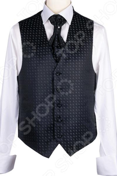 Жилет Mondigo 20639. Цвет: черныйЖилеты<br>Жилет Mondigo 20639 это деталь классического мужского костюма. Сегодня жилет стал неотъемлемой частью гардероба стильного мужчины, следящего за модными тенденциями. Эта модель отлично будет сочетаться с пиджаком. Жилет также можно использовать и как самостоятельный предмет одежды для создания образа в стиле casual . Жилет это возможная альтернатива пиджаку, при этом он не сковывает движения. Этот предмет одежды позволит создать деловой образ, но чувствовать себя гораздо удобнее в теплое время года.<br>
