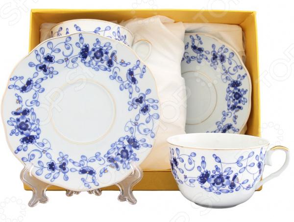 Чайная пара Elan Gallery «Шарм»Чайные и кофейные пары<br>Набор чайных пар Elan Gallery Шарм превосходный комплект на две персоны, который станет великолепным украшением стола. Все элементы выполнены из качественной керамики, которая считается одним из лучших материалом для изготовления посуды для чаепитий и кофепития. Благодаря своим уникальным свойствам, керамика хорошо удерживает тепло и очень богато смотрится на столе. К каждой чашке предусмотрено блюдце, которые идеально дополняют чайный дуэт. Все элементы украшает яркий и четкий цветочный узор, который придает набору праздничный вид. Из таких кружек приятно пить, медленно смакуя и наслаждаясь горячим напитком. Все элементы соединяются в восхитительный чайный ансамбль, который станет элегантным и полезным подарком родственнику, коллеге или близкому другу. Привнесите в свой дом еще больше красоты и уюта!<br>