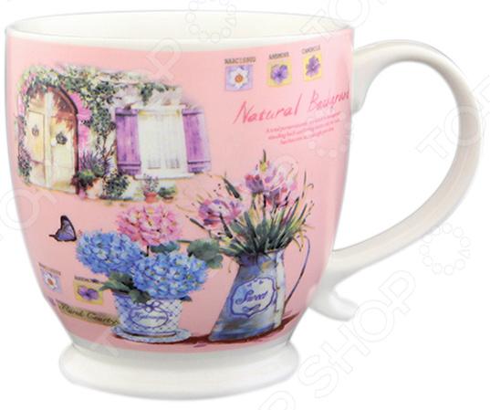 Кружка Elan Gallery «Цветы на розовом»Кружки. Чашки<br>Кружка Elan Gallery Цветы на розовом изготовлена из высококачественной керамики и дополнена романтичным узором. Посуда из этого материала позволяет максимально сохранить полезные свойства и вкусовые качества воды. Заварите крепкий, ароматный чай или кофе в представленной модели, и вы получите заряд бодрости, позитива и энергии на весь день! Классическая форма и яркая цветовая гамма изделия позволят наслаждаться любимым напитком в атмосфере еще большей гармонии и эмоциональной наполненности. Преимущества кружки Elan Gallery Цветы на розовом :  Изготовлена из керамики, что позволяет сохранить полезные свойства и вкусовые качества воды.  Украшена интересным рисунком.  Вмещает большой объем, который составляет 500 мл.  Подойдет в качестве подарка для ваших любимых, родных и близких. В кружке Elan Gallery Цветы на розовом любой напиток станет еще вкуснее!<br>