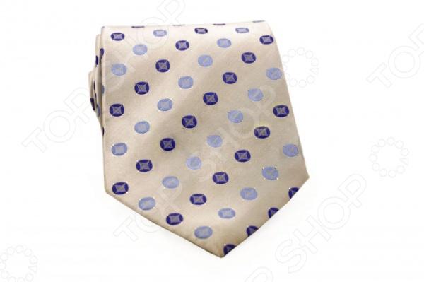 Галстук Mondigo 44573Галстуки. Бабочки. Воротнички<br>Галстук - важный элемент гардероба в жизни каждого мужчины. Сегодня сложно себе представить современного делового мужчину без галстука и это не удивительно, ведь именно галстук является главным атрибутом делового стиля. Не редко, для делового мужчины галстук - одна из немногих деталей, которая позволяет выразить свою индивидуальность, особенно в случаях, когда необходимо соблюдать строгий дресс-код. Однако, галстук уже давно вышел за пределы деловой сферы. Сегодня многие мужчины предпочитающие стиль кэжуал, так же активно прибегают к помощи различных галстуков для создания своего уникального образа. Галстуки стали очень разнообразными как по виду и цвету, так и по форме и материалу изготовления, благодаря этому их можно активно носить не только в офис и на деловых встречах, но даже на отдыхе и в повседневной жизни. Галстук Mondigo 44573 - оригинальная модель, которая станет завершающим штрихом в образе солидного мужчины. Правильно подобранный галстук позволяет эффектно выделить выбранный вами стиль, подчеркнуть изысканность и уникальность его владельца. Оригинальный Галстук белого цвета ручной работы, украшен оригинальным геометрическим узором. Края изделия обработаны лазерным методом. Ширина у основания 8,5 см.<br>