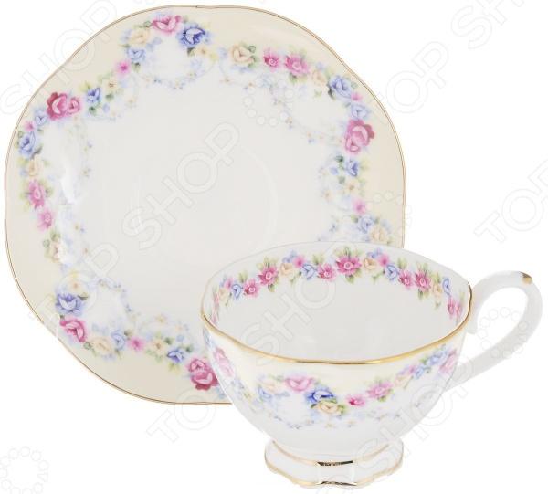 Чайная пара Elan Gallery «Гирлянда из роз»Чайные и кофейные пары<br>Каждая хозяйка знает насколько важна в кулинарии сервировка и правильная подача блюд. От того как блюдо оформлено, в какой посуде подано и как смотрится на тарелке, зависит едва ли не половина вашего успеха. Чайная пара Elan Gallery Гирлянда из роз станет отличным дополнением к набору посуды и прекрасно подойдет для сервировки стола. Посуда выполнена из высококачественной керамики и украшена оригинальным цветочным рисунком. В набор входит чашка и блюдце.<br>