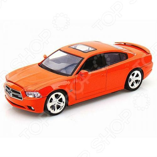 Модель автомобиля 1:24 Motormax Dodge Charger R/T 2011. В ассортиментеМодели авто<br>Товар продается в ассортименте. Цвет изделия при комплектации заказа зависит от наличия товарного ассортимента на складе. Модель 1:24 Dodge Charger R T 2011 представляет собой точную копию американского маслкара. Коллекционная модель выпущена известной компанией по производству игрушек Motormax. Особенность коллекции в том, что все модели изготовлены по лицензии именитых автопроизводителей. Машина изготовлена из металла с элементами пластика и обладает потрясающей детализацией. У нее открываются капот, двери, вращаются и поворачиваются колеса. В самых мельчайших подробностях можно рассмотреть моторный отсек и панель приборов. Яркий автомобиль разнообразит игровые ситуации, откроет новые сюжеты для маленького автолюбителя и поможет развить мелкую моторику рук, внимание и координацию движений. Модель 1:24 Dodge Charger R T 2011 является отличным подарком не только ребенку, но и коллекционеру.<br>