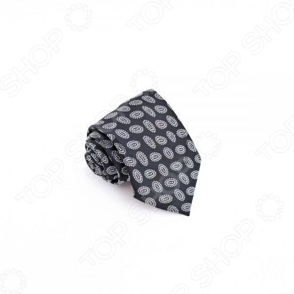 Галстук Mondigo 34560Галстуки. Бабочки. Воротнички<br>Галстук Mondigo 34560 это стильный аксессуар, необходимый для создания элегантного вида. Изготовлен из высококачественной микрофибры. Галстук украшен необычным орнаментом, имеет приятный оттенок. Дополнит наряд в классическом стиле. Все швы обработаны лазером и потому практически незаметны. Отлично подойдет для делового костюма. С этим галстуком вы сможете привлечь взгляды, и обратить на себя должное внимание.<br>