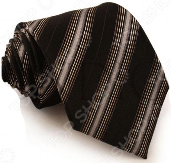 Галстук Mondigo 44161Галстуки. Бабочки. Воротнички<br>Галстук Mondigo 44161 завершающий штрих в образе солидного мужчины. Сегодня классический стиль в одежде приветствуется не только на работе в офисе. Многие люди предпочитают в качестве повседневной одежды костюм или рубашку с галстуком. Мужчина, выбирающий такой стиль в одежде, всегда выделяется среди окружающих и производит положительное первое впечатление. Кроме того, один и тот же галстук можно носить по-разному каждый день. Достаточно выбрать один из многочисленных типов узлов: аскот, балтус, кент, пратт и многие другие. Кстати, в интернете есть сайты, которые случайным образом предлагают вариант узла удобно, когда трудно определиться с выбором . Галстук изготовлен из шелка. Ткань довольно прочная, приятная на ощупь и отличается роскошным блеском. С обратной стороны галстук прострочен шелковой ниткой, что позволяет регулировать длину изделия. Края изделия обработаны лазерным методом.<br>