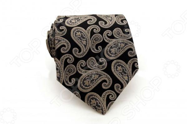 Галстук Mondigo 44365Галстуки. Бабочки. Воротнички<br>Галстук - важный элемент гардероба в жизни каждого мужчины. Сегодня сложно себе представить современного делового мужчину без галстука и это не удивительно, ведь именно галстук является главным атрибутом делового стиля. Не редко, для делового мужчины галстук - одна из немногих деталей, которая позволяет выразить свою индивидуальность, особенно в случаях, когда необходимо соблюдать строгий дресс-код. Однако, галстук уже давно вышел за пределы деловой сферы. Сегодня многие мужчины предпочитающие стиль кэжуал, так же активно прибегают к помощи различных галстуков для создания своего уникального образа. Галстуки стали очень разнообразными как по виду и цвету, так и по форме и материалу изготовления, благодаря этому их можно активно носить не только в офис и на деловых встречах, но даже на отдыхе и в повседневной жизни. Галстук Mondigo 44365 - оригинальная модель, которая станет завершающим штрихом в образе солидного мужчины. Правильно подобранный галстук позволяет эффектно выделить выбранный вами стиль, подчеркнуть изысканность и уникальность его владельца. Элегантный галстук из шелка черного цвета, украшен восточным принтом пейсли, края обработаны лазерным методом. С обратной стороны галстук прострочен шелковой ниткой, что позволяет регулировать длину изделия. Ширина у основания 8,5 см.<br>