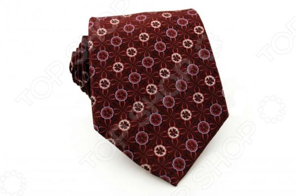 Галстук Mondigo 41018Галстуки. Бабочки. Воротнички<br>Галстук Mondigo 41018 это галстук из 100 шелка, украшен восточно-цветочным принтом, а края изделия обработаны лазерным методом. Он подходит как для повседневной одежды, так и для эксклюзивных костюмов. Подберите галстук в соответствии с остальными деталями одежды и вы будете выглядеть идеально! В современном мире все большее распространение находит классический стиль одежды вне зависимости от типа вашей работы. Даже во время отдыха многие мужчины предпочитают костюм и галстук, нежели джинсы и футболку. Если вы хотите понравится девушке, то удивить ее своим стилем это проверенный метод от голливудских знаменитостей. Для того, чтобы каждый день выглядеть по-новому нет необходимости менять галстуки, можно сменить вариант узла, к примеру завязать:  узким восточным узлом, который подойдет для деловых встреч;  широким узлом Пратт , который прекрасно смотрится как на работе, так и во время отдыха;  оригинальным узлом Онассис , который удивит всех ваших знакомых своей неповторимый формой.<br>