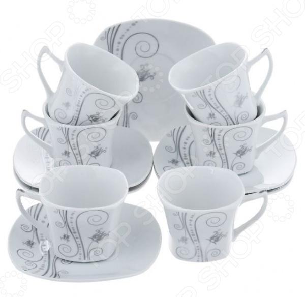 Чайный набор Bekker BK-5983Чайные и кофейные наборы<br>Чайный набор Bekker BK-59863 не просто станет прекрасным дополнением к набору кухонных принадлежностей, но и внесет яркий акцент в сервировку вашего стола. К тому же, он будет отличным приобретением или подарком для любителей чая и позволит превратить обычное чаепитие в настоящий ритуал. Посуда отличается стильным дизайном и великолепным качеством исполнения, изготовлена из высококачественного фарфора и украшена оригинальным рисунком. В комплект входят шесть чайных чашек с блюдцами. Набор упакован в красивую подарочную коробку.<br>