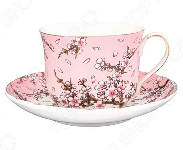 Чайная пара Elan Gallery «Сакура на розовом»Чайные и кофейные пары<br>Не секрет, что любые блюда и напитки требуют особой подачи и сервировки. Это позволяет вам и вашим гостям насладиться не только их прекрасным вкусом, но и получить настоящее эстетическое удовольствие. Не исключением является и чай, для подачи которого используются чайные сервизы или, так называемые, чайные пары. Чайная пара Elan Gallery Сакура на розовом станет отличным дополнением к набору вашей посуды и прекрасно подойдет для сервировки стола. В набор входит блюдце и чайная чашка объемом 400 мл. Посуда выполнена из высококачественной керамики и украшена оригинальным цветочным рисунком.<br>