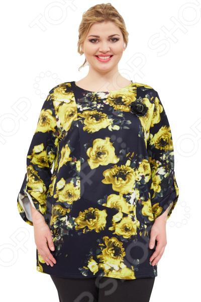 Туника СВМ-ПРИНТ «Домина». Цвет: желтыйТуники<br>Туника СВМ-ПРИНТ Домина незаменимая вещь в гардеробе модницы. Подойдет для женщин практически любой комплекции, ведь особенности кроя помогают скрыть недостатки и подчеркнуть достоинства фигуры. Эта блуза отлично подойдет для повседневного использования.  Универсальная длина до середины бедра и чуть расклешенный силуэт скрывают недостатки и подчеркивают достоинства, поэтому туника подходит женщинам с любой фигурой.  Круглый вырез горловины.  Рукава 7 8 с защипами по бокам.  Украшение в виде цветка пришито, оно позволит всегда быть на высоте!  На фото с брюками Миледи. Туника изготовлена из высококачественной ткани 100 полиэстер . Уникальная модель, которую можно приобрести только на нашем телеканале!<br>