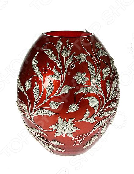 Ваза декоративная Tango 58230Вазы<br>Ваза декоративная Tango 58230 это симпатичная стеклянная ваза, которая украсит любой интерьер. Ваза представляет собой не просто подставку для цветов, а настоящее произведение искусства. Она сочетает в себе изысканный дизайн и максимальную функциональность, поможет вам подчеркнуть дизайн помещения, сделать акцент или украсить пустое пространство на полке. Такая ваза будет удачно смотреться как в прихожей, так и в гостиной или спальне. А может вы решили украсить дачу или загородный дом Попробуйте разнообразить интерьер с помощью ваз, в которые можно сразу поставить свежие цветы! Дача преобразится и заиграет новыми красками! Стеклянные вазы очень практичные, ведь их легко мыть. Стекло представляет собой уникальный материал, который не впитывает запах и если вы обнаружите аллергию на цветы, то быстро сможете избавиться от пыльцы и аромата. При необходимости вазу такого типа легко очистить с помощью мыльной воды, можете использовать мягкую губку. Этот предмет интерьера может стать хорошим подарком для любой женщины.<br>