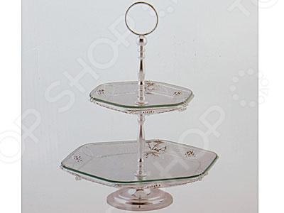 Ваза двухъярусная Rosenberg 3222Сервировочные блюда и тарелки<br>Ваза двухъярусная Rosenberg 3222 - красивая и универсальная ваза, которая станет отличным функциональным украшением любого интерьера. Стильная и элегантная ваза отличается своей удивительной вместительностью, так как состоит из двух ярусов необычной многоугольной формы, на которых можно расположить как фруктовый букет, так и сладости, которые вы собираетесь подать к чаю. Благодаря своему изысканному и утонченному дизайну, ваза может стать не только идеальным украшением любого торжественного мероприятия, но и великолепным подарком для ваших близких. Преимущества двухъярусной вазы Rosenberg 3222:  прочная и универсальная конструкция;  проста в уходе и использовании;  удивительная детализация;  оригинальный дизайн.<br>