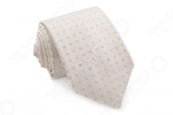 Галстук Mondigo 34043Галстуки. Бабочки. Воротнички<br>Галстук Mondigo 34043 - стильный мужской галстук, выполненный из микрофибры, которая обладает высокой устойчивостью и выдерживает богатую палитру оттенков. Галстук белого цвета, украшен орнаментом из мелких квадратиков. Такой стильный галстук будет очаровательно смотреться с мужскими рубашками темных и светлых оттенков. Упакован галстук в специальный чехол для аккуратной транспортировки. Дизайн дополнит деловой стиль и придаст изюминку к образу строгого делового костюма.<br>