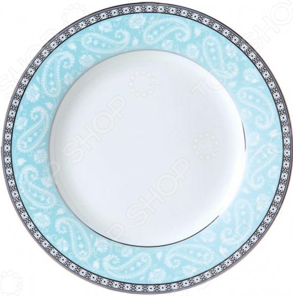 Тарелка суповая Esprado Arista BlueСуповые тарелки<br>Сервировка как искусство Владение искусством кулинарии это умение не только вкусно готовить, но и красиво преподносить кулинарные шедевры. Очень важную роль играет, конечно же, посуда. Именно она является обрамлением блюда, его гармоничным продолжением. Посуда должна красиво дополнять пищу, подчеркивать ее аппетитность, изысканность и отменный вкус самой хозяйки. Тарелка суповая Esprado Arista Blue это идеальное решение для вашего стола. Изящное и практичное изделие, которое подойдет для сервировки самых разнообразных блюд: горячего, холодных закусок, фруктовых и овощных ассорти, кондитерских изделий, салатов, нарезок и пр.  Качественно, практично, красиво! Блюдо изготовлено из костяного фарфора, который обладает массой полезных свойств:  не содержит токсичных веществ и тяжелых металлов;  отлично взаимодействует с продуктами питания;  подходит для длительного хранения продуктов;  легко очищается от загрязнений;  выдерживает воздействие повышенных температур;  не впитывает запахи;  обладает красивейшей текстурой. Хозяйку порадуют не только достойные потребительские качества изделия, но и его великолепный дизайн. Бортики блюда представлены изящным растительным орнаментом в бело-голубой гамме. А монохромная кайма органично завершает всю композицию. Такая тарелка станет настоящим украшением обеденного стола! Коллекция посуды Arista изысканность и роскошь, элегантность и красота в одном флаконе. Все это умело воплощено талантливыми мастерами в столовой посуде от Esprado. Наслаждайтесь любимыми блюдами в кругу самых дорогих людей!<br>