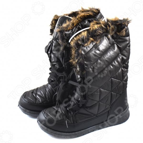 Сапоги женские АЛМИ «Василиса». Цвет: черныйСапоги<br>Сапоги женские АЛМИ Василиса модная и комфортная обувь для холодного времени года. Они сделаны из легких и мягких материалов, поэтому прекрасно подойдут для продолжительных зимних прогулок по снегу. Однако водоотталкивающая поверхность делает эти сапоги также подходящими для дождливого дня.  Идеальное решение для холодной, ветреной и сырой погоды. Обувь не потрескается от сильного мороза, не пропустит влагу и не будет скользить.  Подкладка из искусственного меха хорошо сохраняет тепло. При этом материалы позволяют коже дышать .  Сделаны по уникальной немецкой технологии литьевого крепления.  Высокая устойчивая подошва из ПВХ.  Модель модного типа дутики . Сапоги выдерживают температуру вплоть до -15 и не требуют особого ухода.<br>