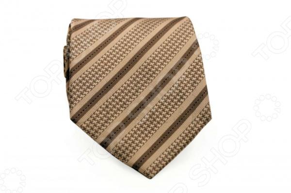 Галстук Mondigo 44538Галстуки. Бабочки. Воротнички<br>Галстук Mondigo 44538 - классический шелковый галстук, который является одной из важнейших и незаменимых деталей в гардеробе каждого мужчины. Правильно подобранный галстук позволяет эффектно выделить выбранный вами стиль, подчеркнуть изысканность и уникальность его владельца. Стильный галстук ручной выполнен из натурального 100 шелка бежевого цвета и украшен тонкой диагональной линией, оригинальным геометрическим узором. Обратная сторона изделия прошита специальной шелковой нитью, с помощью которой можно самостоятельно регулировать длину галстука. Этот стильный галстук эффектно дополнит любой деловой костюм и будет уместен как в офисе, так и на торжественных мероприятиях. С этим галстуком даже самый строгий костюм будет выглядеть стильно и современно. Ширина у основания - 8,5 см.<br>