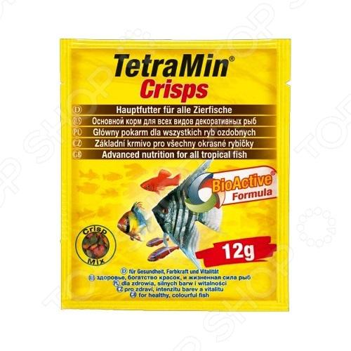 Корм для декоративных рыб Tetra MinPro Crisps 12гВитамины и добавки. Корм для рыб<br>Корм для декоративных рыб Tetra MinPro Crisps 12г это основной корм, который подходит для ежедневного употребления в рацион ваших любимых аквариумных рыбок. Этот корм универсален, ведь он состоит из 40 видов отборного высококачественного сырья, которые произведены путем бережной обработки сырья и подходит для всех видов рыб, которые кормятся у поверхности воды. После того, как рыбы насытятся, вам не придется очищать аквариум от избытка корма, ведь хлопья долго сохраняют свою форму и плавают на поверхности, их довольно скоро съедят более голодные рыбки. Тщательно отобранная комбинация из высококачественных питательных веществ, витаминов и минералов для полноценного, здорового питания.<br>
