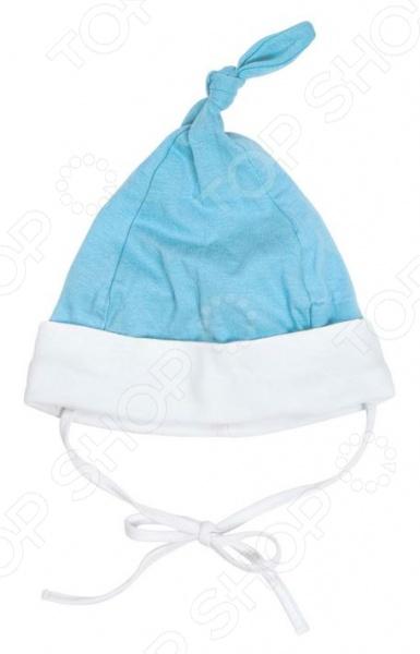 Шапочка детская Курносики 3093012 на завязках является незаменимым предметом одежды в гардеробе новорожденных. Модель отличается великолепным качеством пошива и стильным дизайном, мягкая и приятная на ощупь. Шапочка произведена по технологии Safe inside , обеспечивающей особую деликатность швов и позволяющей избежать натирания и появления на коже ребенка раздражений. Изделие выполнено из хлопкового трикотажа, отлично зарекомендовавшего себя в пошиве детской одежды, благодаря воздухопроницаемости, прочности и устойчивости к истиранию.
