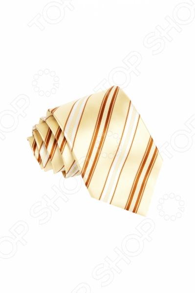Галстук Mondigo 34866Галстуки. Бабочки. Воротнички<br>Галстук - важный элемент гардероба в жизни каждого мужчины. Сегодня сложно себе представить современного делового мужчину без галстука и это не удивительно, ведь именно галстук является главным атрибутом делового стиля. Не редко, для делового мужчины галстук - одна из немногих деталей, которая позволяет выразить свою индивидуальность, особенно в случаях, когда необходимо соблюдать строгий дресс-код. Однако, галстук уже давно вышел за пределы деловой сферы. Сегодня многие мужчины предпочитающие стиль кэжуал, так же активно прибегают к помощи различных галстуков для создания своего уникального образа. Галстуки стали очень разнообразными как по виду и цвету, так и по форме и материалу изготовления, благодаря этому их можно активно носить не только в офис и на деловых встречах, но даже на отдыхе и в повседневной жизни. Галстук Mondigo 34866 - оригинальная модель, которая станет завершающим штрихом в образе солидного мужчины. Правильно подобранный галстук позволяет эффектно выделить выбранный вами стиль, подчеркнуть изысканность и уникальность его владельца. Классический мужской галстук бежевого цвета, украшен изящными полосками по диагонали светло-коричневого и белого цвета. Ширина у основания 8,5 см.<br>
