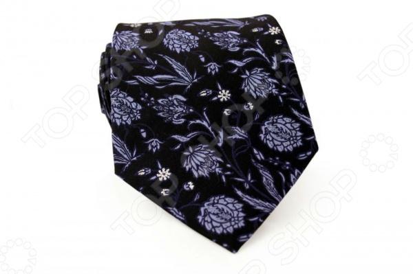 Галстук Mondigo 44446Галстуки. Бабочки. Воротнички<br>Галстук Mondigo 44446 - красивый и оригинальный шелковый галстук, который является одной из важнейших и незаменимых деталей в гардеробе каждого мужчины. Правильно подобранный галстук позволяет эффектно выделить выбранный вами стиль, подчеркнуть изысканность и уникальность его владельца. Стильный галстук выполнен из натурального 100 шелка темного цвета и оформлен элегантным цветочным узором контрастного сиреневого цвета. Обратная сторона изделия прострочена специальной шелковой ниткой, которая позволяет регулировать длину изделия. Этот стильный галстук эффектно дополнит любой деловой костюм и будет уместен как в офисе, так и на торжественных мероприятиях. В нем вы точно не останетесь незамеченным. Ширина у основания - 8,5 см.<br>