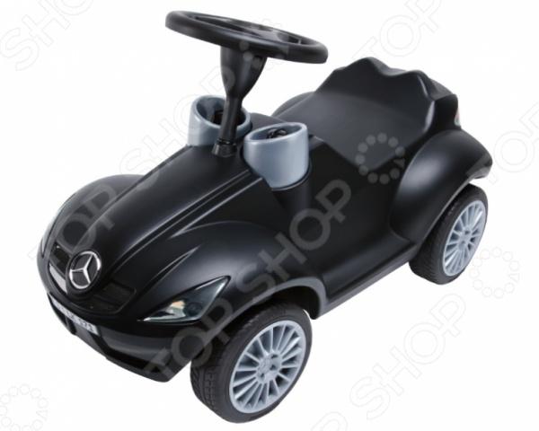 Детский автомобиль BIG SLK-BOBBY-BenzКаталки и качалки<br>Детский автомобиль BIG SLK-BOBBY-Benz предназначен для таких маленьких, но уже таких активных малышей. Машина очень похожа на настоящий Mercedes Benz, ведь она разрабатывалась в тесном сотрудничестве с компанией Daimler AG. На капоте и багажнике красуется фирменный логотип марки трехлучевая звезда. Около руля два колодца со спидометром и тахометром, как в настоящем авто. Модель способствует активному развитию мышц спины, ног и живота. Выполнена из ударопрочного пластика. Оснащена нескользящим рулем с клаксоном и удобным креслом. Защиту от переворачивания гарантируют широкие прорезиненные колеса с многоспицевыми дисками. Не упустите порадовать маленького автомобилиста замечательным подарком!<br>