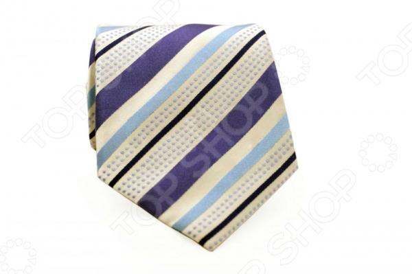 Галстук Mondigo 44575Галстуки. Бабочки. Воротнички<br>Галстук Mondigo 44575 - классический шелковый галстук, который является одной из важнейших и незаменимых деталей в гардеробе каждого мужчины. Правильно подобранный галстук позволяет эффектно выделить выбранный вами стиль, подчеркнуть изысканность и уникальность его владельца. Стильный галстук ручной выполнен из натурального 100 шелка фиолетового цвета и украшен диагональными пунктирными линиями. Для большей прочности и долговечности изделия, его края обработаны специальным лазерным методом. Этот стильный галстук эффектно дополнит любой деловой костюм и будет уместен как в офисе, так и на торжественных мероприятиях. С этим галстуком даже самый строгий костюм будет выглядеть стильно и современно. Ширина у основания - 8,5 см.<br>