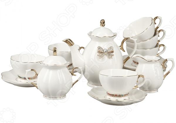 Сервиз чайный Rosenberg RCE-115003-15Чайные и кофейные наборы<br>Сервиз чайный Rosenberg RCE-115003-15 отлично подойдет для сервировки праздничного стола. Он рассчитан на шесть персон и включает в себя: чашки с блюдцами, заварочный чайник, молочник и сахарницу. Посуда выполнена из высококачественных материалов и украшена золотистыми элементами и стразами. Торговая марка Rosenberg это синоним первоклассного качества и стильного современного дизайна. Компания занимается производством и продажей кухонных инструментов, аксессуаров, посуды и т.д. Функциональность, практичность и инновационные решения вот основные принципы торгового бренда Rosenberg.<br>
