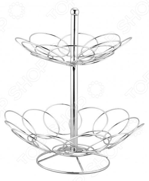 Фруктовница Regent 2-х ярусная TrinaФруктовницы<br>Фруктовница Regent 2-х ярусная Trina станет стильным и изысканным украшением вашего праздничного или обеденного стола. Конечно, чтобы поставить свежие фрукты на стол достаточно сложить их в простую и незамысловатую пластиковую или стеклянную чашу. Однако куда более роскошно и элегантно будет смотреться двухъярусная стальная фруктовая корзинка. Данная модель выполнена из качественного и достаточно прочного стального хромированного прутка, который надолго сохранит свой привлекательный внешний вид. В ней вы также сможете красиво подать сдобную домашнюю выпечку, например, булочки или пирожки. Фруктовница имеет специальное дно, которое обеспечивает удивительную устойчивость изделия. Простой, но в тоже время, элегантный дизайн позволит этой оригинальной миске вписаться в любой антураж и стать центральным элементом праздничной сервировки стола.<br>