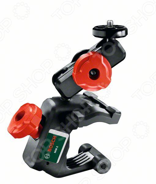 Держатель для измерительного инструмента Bosch MM2 для Quigo III очень практичен и удобен в использовании. Универсальный держатель применяется с лазерным нивелиром Quigo III, в комплектации которого предусмотрен и адаптер. Все составляющие инструмента выполнены из качественного материала, а само основание имеет пластиковый корпус.  Преимущества модели  Резьба штатива 1 4.  Диапазон работы зажима 10 - 60 мм.  Представленная модель позволяет регулировать прибор по высоте, а также крепит инструменты к балкам, перегородкам или стенам.