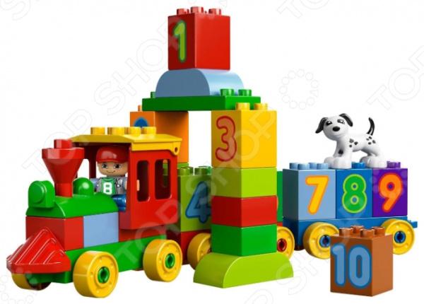 Конструктор LEGO Считай и играй поможет обучить малыша счету. При этом процесс обучения превратится в увлекательную игру, ведь в набор входит паровоз на колесиках с тремя грузовыми вагонами. Состав везет разноцветные кубики с цифрами от 1 до 10. Есть и другие детальки, что позволяет построить арку или любое другое строение. Паровоз ведет машинист в красной кепке, а сопровождает его верный пес далматинец. LEGO знаменитый бренд в мире игрушек, радующий детей с 1932 года. Деятельность компании охватывает 130 стран по всему миру. Их игрушки направлены на развитие творческого мышления ребенка в ходе игры. Однако конструкторы LEGO любимы не только детьми, но и взрослыми.