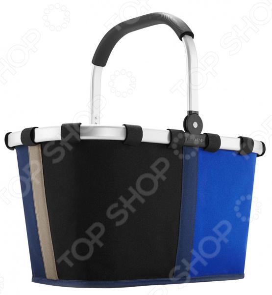 Корзина для продуктов Reisenthel Carrybag patchwork - корзина для похода за продуктами. С такой корзиной вы определенно будете самым стильным посетителем магазина. Ее удобно хранить, корзина хорошо складывается и занимает минимум места. Основой корзины служит крепкая алюминиевая конструкция. Ручка сделана из приятного прорезиненного пластика. Для дополнительного удобства внутри есть карман на молнии для мелочевки. Объем сумки - 22 литра.
