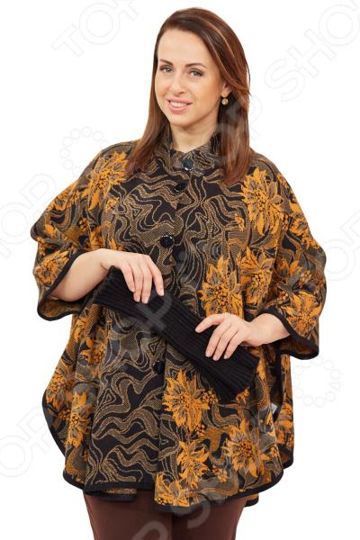 Пончо Milana Style Верона это универсальная накидка, которая подойдет на любой возраст и стиль одежды, подойдет как для праздничных мероприятий, так и для повседневной носки. Выделка шерсти, фактурный рисунок и необычный дизайн, делает эту вещь уникальной. Классический крой и удобная длина до середины бедра будут идеально смотреться на женщинах с любым типом фигуры и любого возраста. Пончо свободного силуэта с короткими рукавами, подчеркивающими форму женской руки. Воротник стойка с застежкой на пуговицы удлиняет шею и украшает область декольте, а широкие рукава скрывают недостатки в области плеч. Всеми любимый узор цветы всегда актуален для любой модницы, а широкая однотонная окантовка по деталям подчеркивает силуэт модели. На фотографии пончо представлено с брюками Уран . В подарок идут митенки. Материал очень приятный к телу шерсть 30 ; пан 70 , прекрасно подойдет для прохладной осенней погоды. Такая ткань не линяет, не скатывается, формы от стирки не теряет.