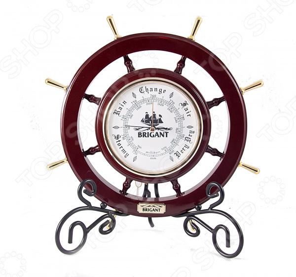 Барометр настенный Brigant 28115 это не только изысканное украшение интерьера, но и функциональное устройство для измерения атмосферного давления. Стильный деревянный корпус выполнен в форме корабельного штурвала, окрашен в благородный цвет и отполирован до зеркального блеска. В центр вмонтирован механический барометр с металлической рамкой, под которой красуется две витиеватые вешалки для шляп. Механизм надежно защищен от повреждений толстым слоем стекла и четко просчитывает данные. Изделие поможет вам прогнозировать изменения погоды в ближайшее время. Чтобы сохранить лоск, предмет нужно иногда протирать мягкой тканью. Устройство послужит благородным украшением интерьера, позволяя чувствовать себя истинным аристократом. Настенный барометр восхитительный подарок, который не только порадует владельца, но и окажется весьма полезным приобретением.