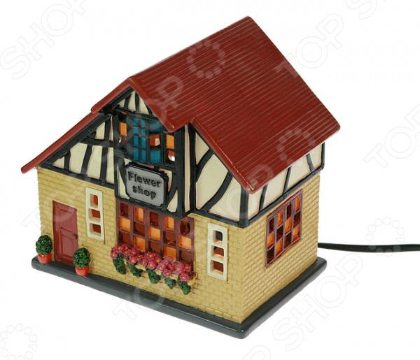 Светильник Домик люминесцентная лампа, станет оригинальным дополнением интерьера комнаты. Классический светильник питается от сети. Выполнен из прочных материалов, которые не содержат вредных веществ и совершенно безопасны для здоровья. Работает от сети 220-240 В. Используется лампа E14. Рекомендуется регулярно удалять пыль сухой, мягкой тканью.