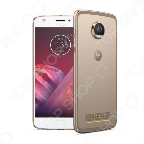 Смартфон Motorola Moto Z2 Play великолепная, современная модель с версией Android 7.1.1 и впечатляющими параметрами для развлечений и работы! Смартфон создан для долгой и качественной службы, поэтому сочетает в себе прочные и эффективные материалы, эргономичность, идеальный баланс между производительностью и временем работы от аккумулятора, мощную и современную систему с регулярным обновлением программного обеспечения. Современная модель смартфона Motorola Moto Z2 Play выполнена с использованием современного высокоточного оборудования. Этот девайс позволит вам оставаться со своими родными и близкими на связи, где бы вы не находились. В комплекте идет чехол WoodPanel ASMCAPCHAHEU.  Мощный процессор для высокой производительности В основе устройства лежит мощный 8-ядерный процессор Qualcomm Snapdragon 626, который относится в процессорам современного поколения. Он обеспечивает высокий уровень графики и продолжительную работу устройства от аккумулятора. Теперь игры стали работать быстрее, а расход энергии экономичней. Регулярное обновление ОП гарантирует полную безопасность и соответствие устройства современным требованиям.  Все для комфортного использования!  Высококачественный экран изготовлен по технологии AMOLED. Для дополнительной прочности и безопасности экран покрыт специальным защитным стеклом нового поколения Corning Gorilla Glass.  Основная камера 12 Мпикс оснащена множеством функций съемки и быстрым автоматическим фокусом, что позволяет запечатлеть лучшие моменты во всех красках.  Фронтальная 5 Мпикс идеально подходит для съемки селфи и видеозвонков. Оснащена эффектами улучшения автопортрета.  Сканер отпечатков пальца удобно расположенный. Он позволяет не только разблокировать смартфон без ввода пин-кода, но и закрыть доступ к личному пространству, конфиденциальной информации.  Поддерживает внешние носители объемом до 2 Тб.  Набор необходимых датчиков: G-сенсор акселерометр , гироскоп, датчик приближения, магнитометр.  Современный дизайн Дизайн смартфона Mot