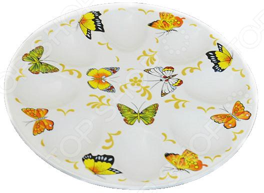 Менажница для яиц Elan Gallery Бабочки станет украшением вашего стола. Красивое оформление стола как праздничного, так и повседневного это целое искусство. Правильно подобранная посуда это залог успеха в этом деле. Такая менажница придется по вкусу даже самым требовательным хозяйкам и придаст особый шарм и очарование сервируемому столу. Менажница это весьма популярное блюдо для сервировки стола. Удобство менажниц оценили многие хозяйки, ведь на одном блюде вы сможете разместить сразу несколько фаршированных яиц и подать их на стол.