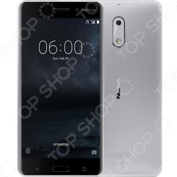 Смартфон Nokia 6 32GB великолепная, современная модель с новейшей версией Android и впечатляющими параметрами для развлечений и работы! Смартфон создан для долгой и качественной службы, поэтому сочетает в себе прочные и эффективные материалы, эргономичность, идеальный баланс между производительностью и временем работы от аккумулятора, мощную и современную систему с регулярным обновлением программного обеспечения.  Современная модель смартфона Nokia 6 позволит вам оставаться со своими родными и близкими на связи, где бы вы не находились. Высокое качество связи, возможность попеременного использования сразу двух sim-карт обеспечивают максимальный комфорт и быстрый доступ ко всем вашим контактам. Теперь вам больше не придется все время носить с собой два телефона: личный и рабочий. Компактная и практичная модель позволит вам объединить их в одно устройство!  Высокий уровень производительности  Смартфон Nokia 6 выпускается с чистой ОП Android Nougat без ненужных, предустановленных дополнений.  Регулярное обновление ОП гарантирует полную безопасность и соответствие устройства современным требованиям.  Процессор Qualcomm Snapdragon 430 относится в процессорам современного поколения и обеспечивает высокий уровень графики и продолжительную работу устройства от аккумулятора.  Полный набор сервисов Google позволяет быстро настроить телефон.  Внутренняя память объемом 32 Гб, а также поддержка карт microSD емкостью до 128 ГБ.  Все для комфортного использования!  Дисплей full-HD с диагональю 5,5 и превосходной цветопередачей позволяет с комфортом использовать устройство даже при ярком солнечном свете.  Широкий угол обзора позволяет удобно смотреть видео вместе с друзьями!  Два динамика и отдельный усилитель гарантируют мощный, чистый и громкий звук с глубокими басами. Данная модель поддерживает технологию Dolby Atmos.  Смартфон располагает основной камерой 16 Мпикс с фазовым автофокусом для идеальных снимков и фронтальной камерой 8 Мпикс для сэлфи и видеозвонков. Двухцветная всп